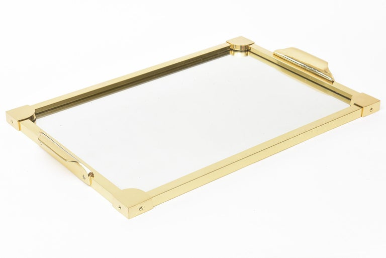 This fabulous substantial Italian solid brass modernist rectangular vintage tray has all been professionally polished. It is Mid-Century Modern and the applications for this serving tray and or barware are endless. It is a rectangular size. Great