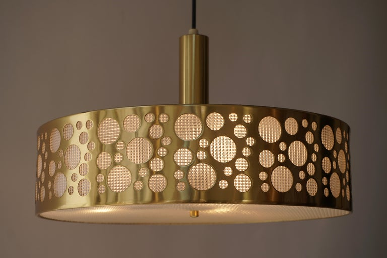 Mid-Century Modern brass 3-light chandelier, ceiling light, circa 1970. Shaped as an UFO or flying saucer, a popular topic during the