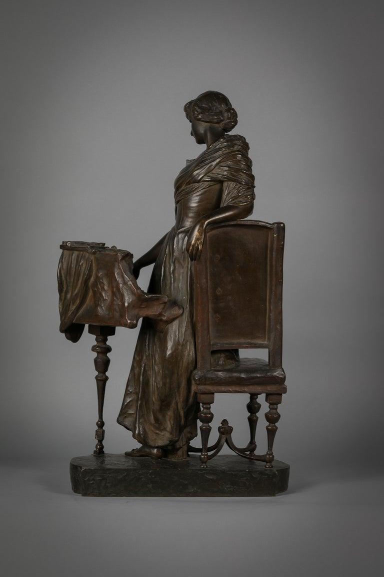 Italian bronze sculpture of woman playing a pianoforte, signed Saverid Sortini (1860-1925).
