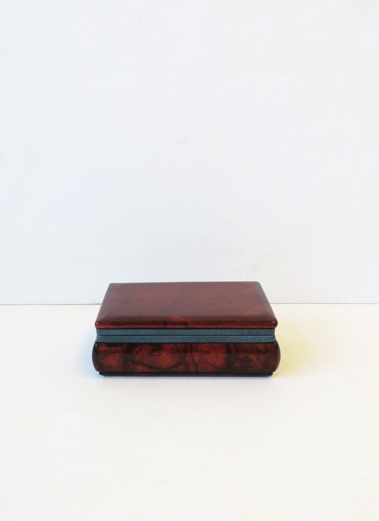 An Italian dark brown alabaster marble jewelry box with a blue matte metal hinge. Box can hold jewelry or other small items. Marked made in Italy on bottom as show in image #15 and 16. A great piece for a desk, vanity, nightstand, walk-in closet