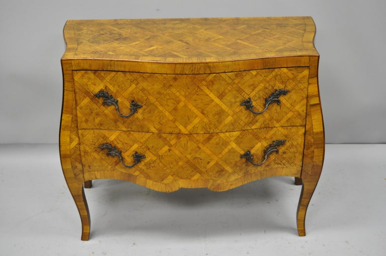 Italian burl olive wood parquetry inlaid French style bombe commode chest. Item features beautiful parquetry inlaid burl olive wood, shapely bombe form, original label, cabriole legs, great style and form, circa early to mid-20th century.