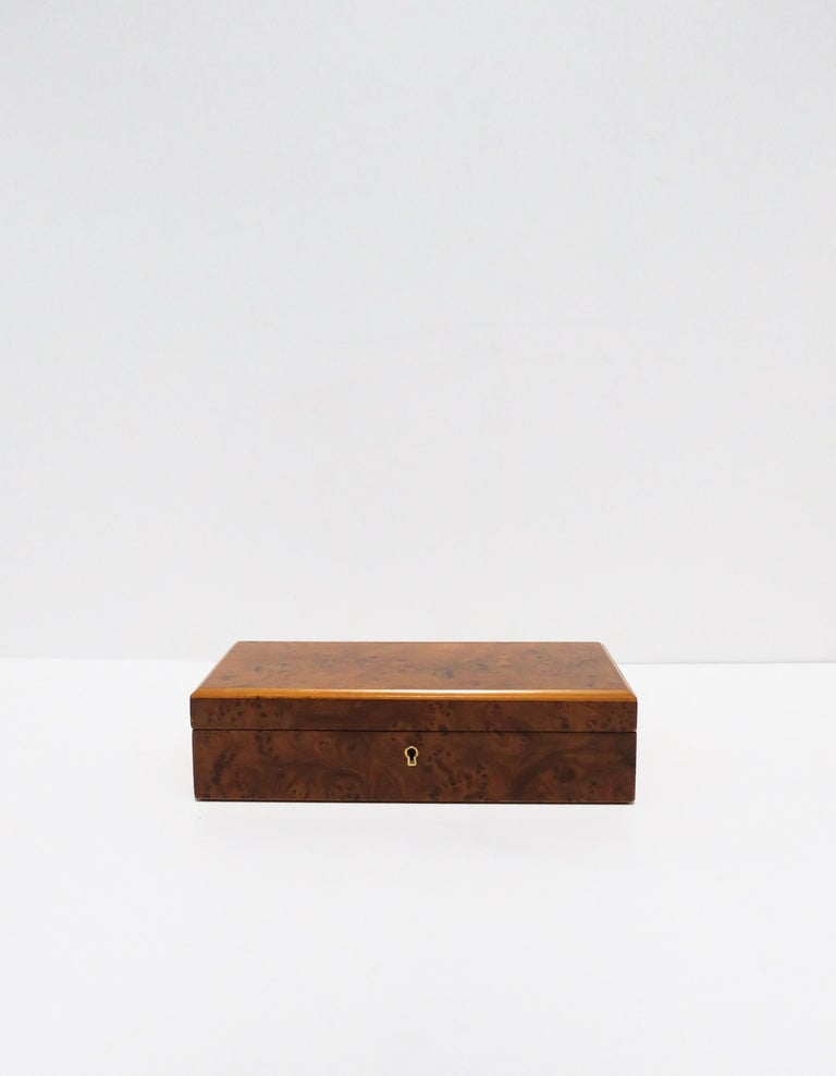 An Italian burl wood veneer jewelry box with velour interior and brass hardware, circa 20th century, 1960-1970s, Italy. Box has a nice easy open/close. Marked on bottom: