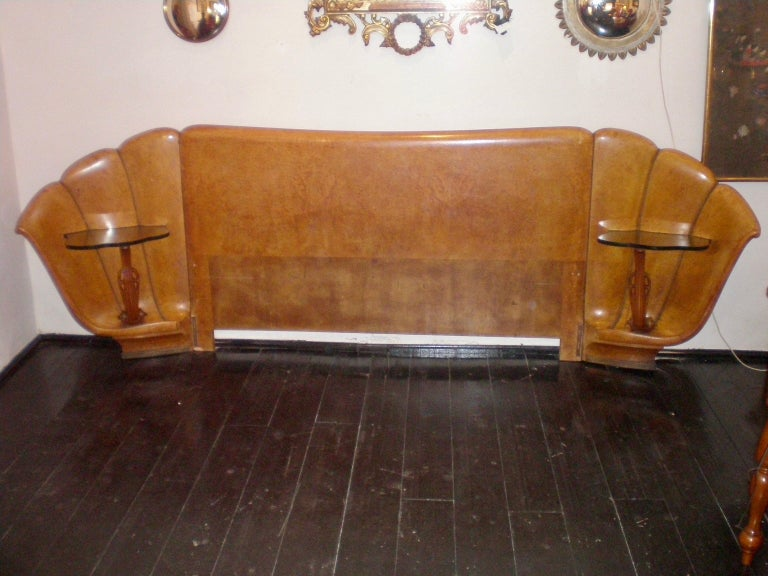 Italian burled walnut Art Deco headboard with attached shell shaped nightstands with brass studded inlays.  The nightstands have a scalloped crystal top. The headboard consists of three wood pieces that can be disassembled. Queen size bed frame. The