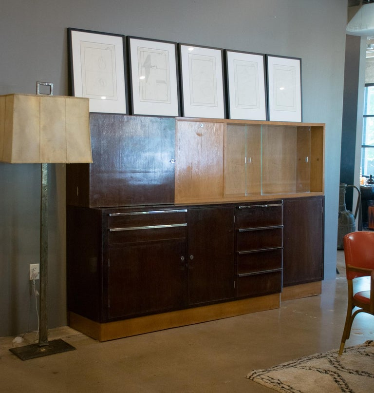 Handsome Italian cabinet, circa 1930s or 1940s, in deep rosewood and birch. The fine contrasting woods and finish reflect the Art Deco aesthetic while the simple geometry and utilitarian hardware suggest the Bauhaus. The upper cabinet has two doors
