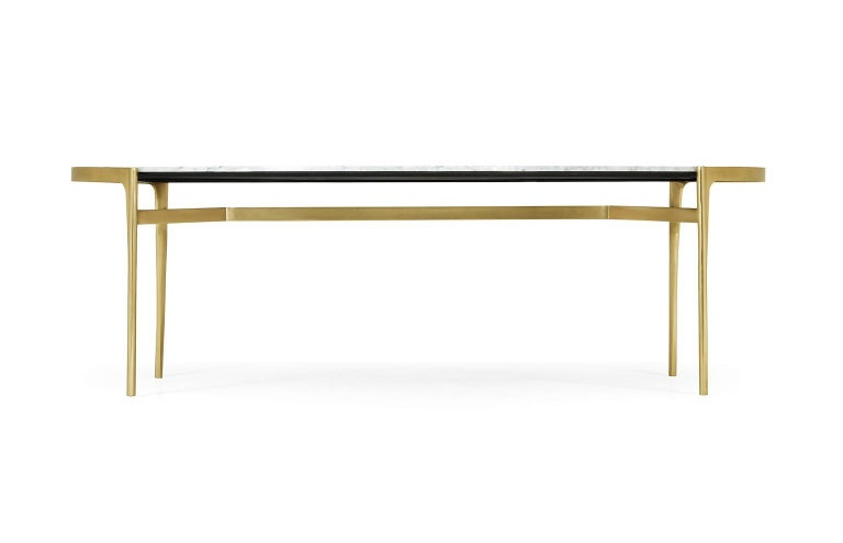Handcrafted white marble dining table featuring a gold brass base in satin finish. Material: Italian White Calcutta, Fully Loaded Brass Color: White, Gold Dimensions: 96''w x 54''d x 30''h Weight: 730 lbs