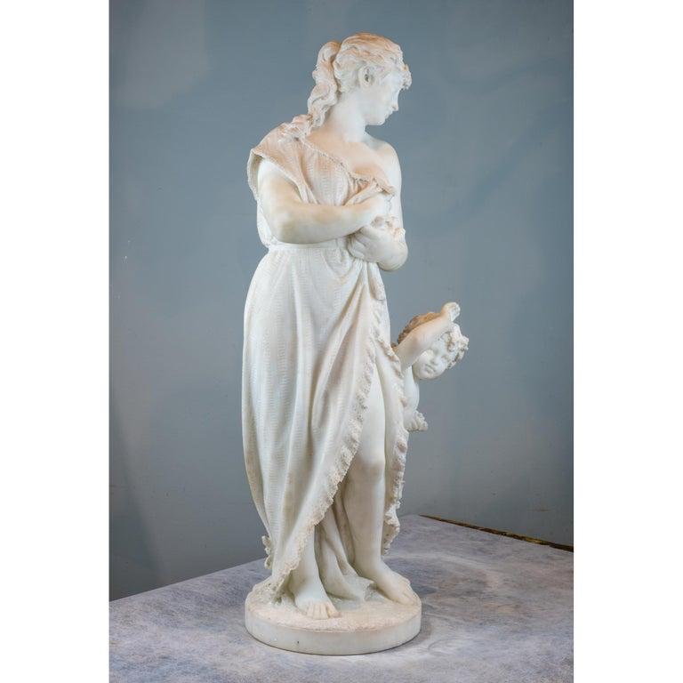 Finely carved Italian Carrara marble   Title: Amore E Psiche Artist: Pasquale Romanelli (1812-1887) Origin: Italian Date: 19th century Signature: Signed Prof. P. Romanelli/Firenze Dimension: Statue: height 30½ in. x 12 1/2 in.