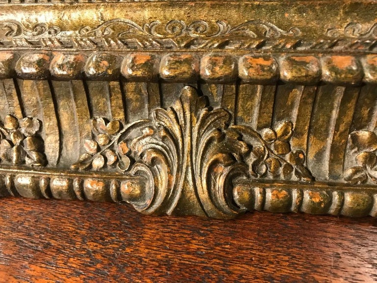 This is a wonderful Baroque style tabletop box that would also make a great humidor. The detailed carving and worn gilded surface patina make this an unusual and compelling piece. Brings to mind the age of the Robber Barons, I could see this on the