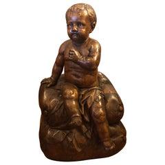 Italian Carved Walnut Baby on Cushion