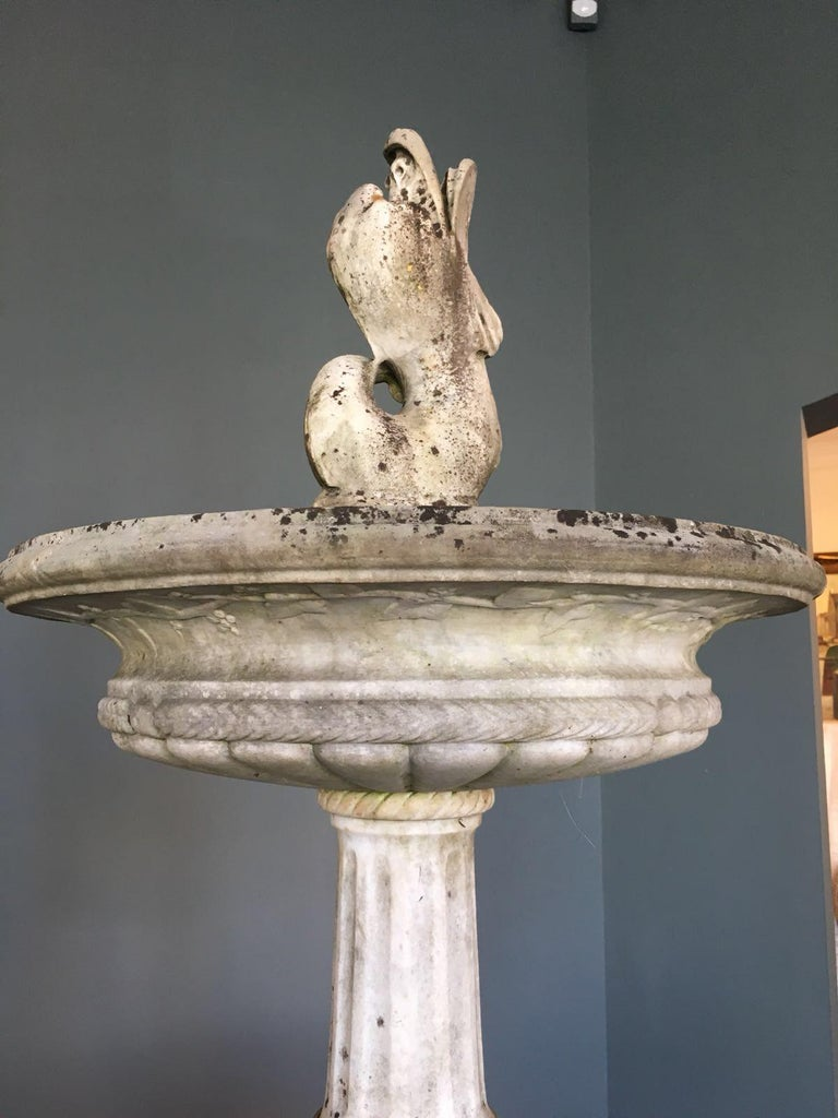 White marble fountain with two tanks.