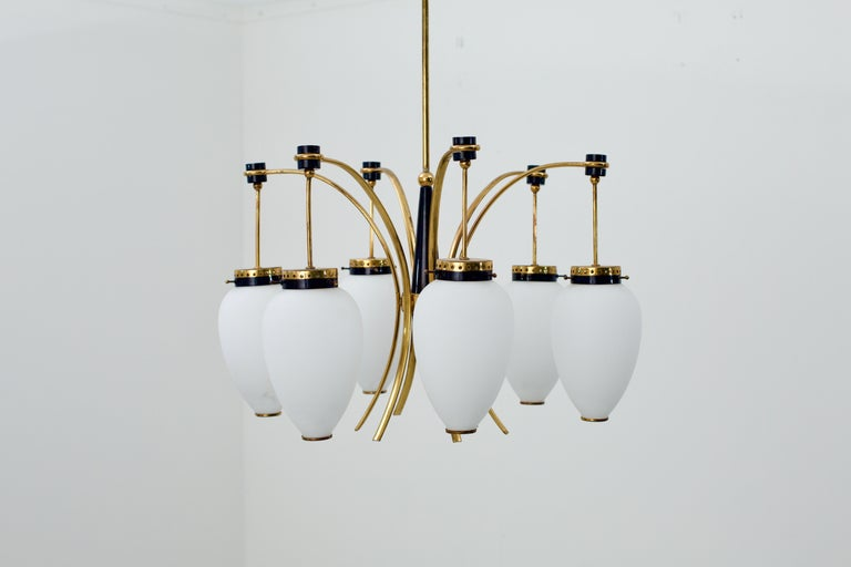 Classic 1950s Italian ceiling lamp in metal, brass and opaline glass. Nice color combination make this piece a joy to look it. The shiny black of the metal and gold of the brass really jump out. The cony white opaline glass serves as a good