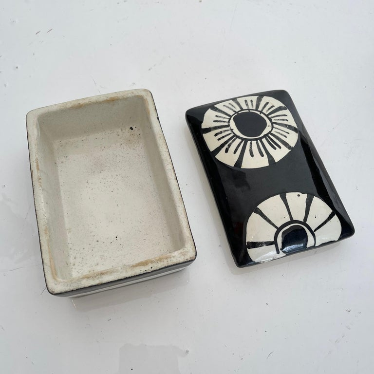 Elegant ceramic box made in Italy, circa 1970s. Black and white color theme with white flowers. Great condition. Perfect stash box or tabletop object. Marked Made in Italy on underside.