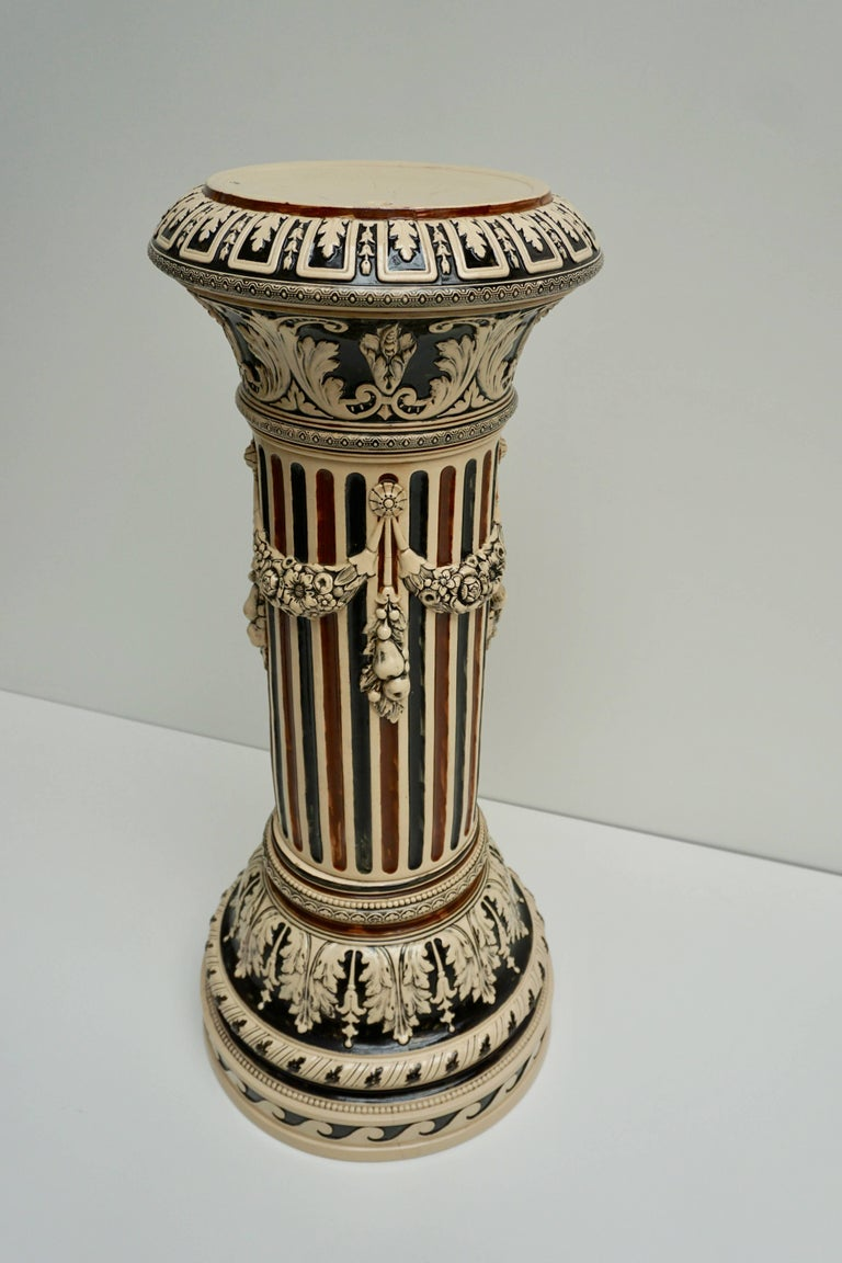 Italian ceramic pedestal with guirlanders.