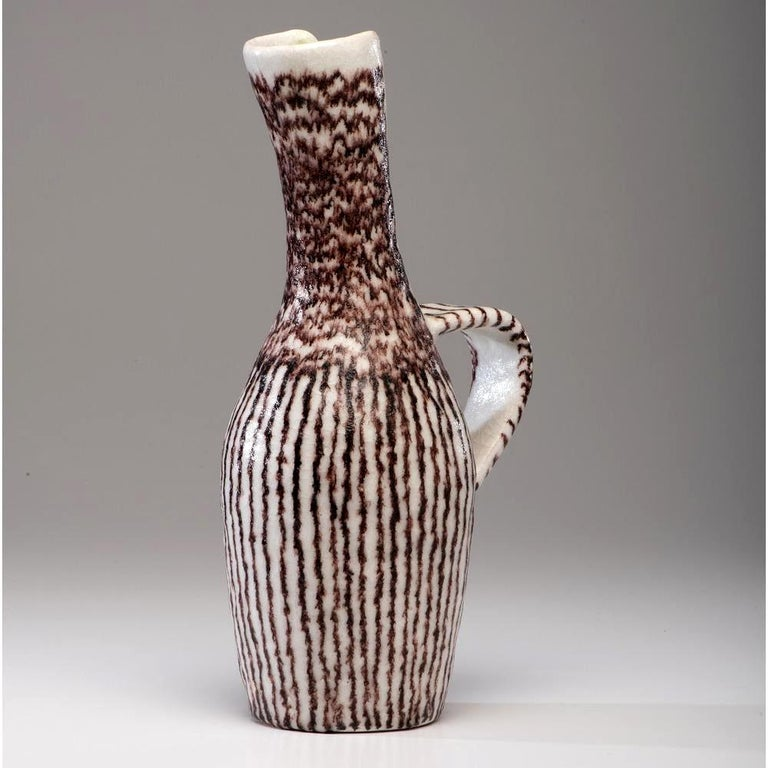 A large sculptural stoneware pitcher by Italian ceramic artist and designer Guido Gambone (1909-1969), circa 1950s. This vessel takes an elegant sculptural form from the Classic antiquity form, seen in both Greek and Persia. An elongated and