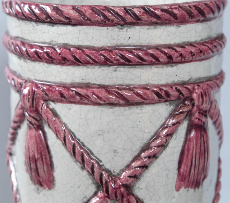White and pink rope and tassel ceramic umbrella stand from Italy.