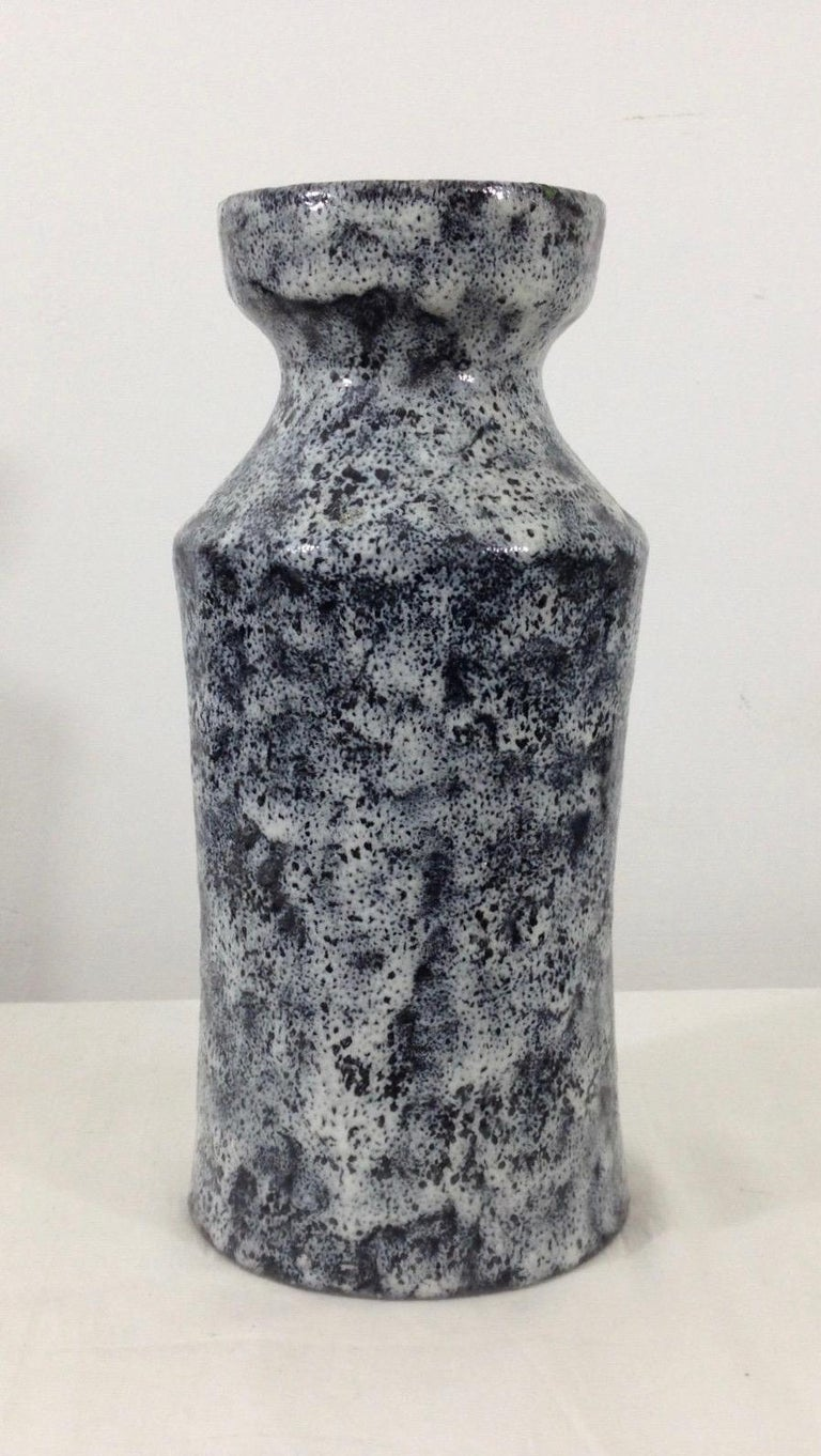 Beautiful ceramic vase by Raymor. Great lave glaze, with black and white coloring. Very good vintage condition.