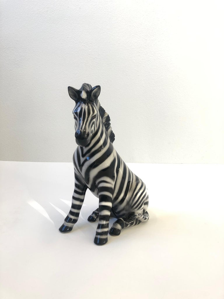 """Large Italian ceramic zebra sculpture from the 1970s. Hand painted and glazed. Marked made in Italy. Measurements: 21.25"""" high, 17"""" wide and 9"""" deep."""