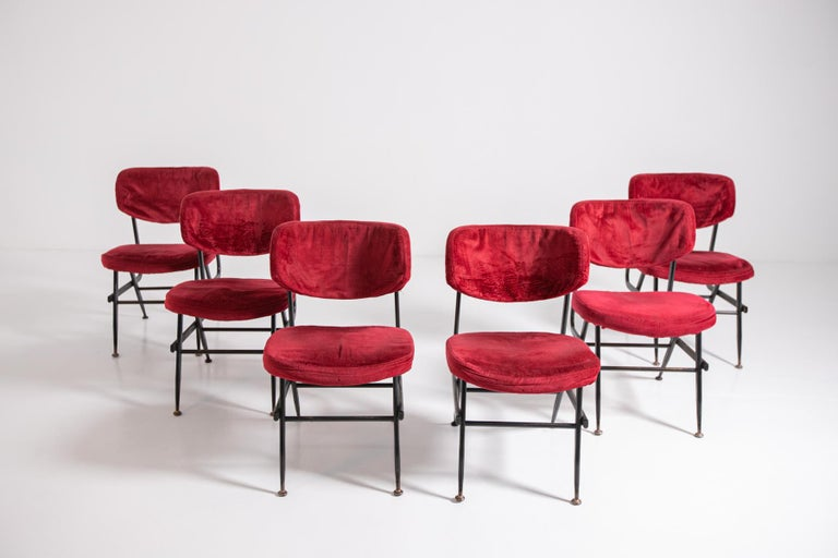 Beautiful set of six Italian chairs from the 1950s. The set has a black painted iron frame, forming geometric lines and a pleasing style. The feet have round brass ferrules, while the seat and backrest upholstery is in dark red velvet original to