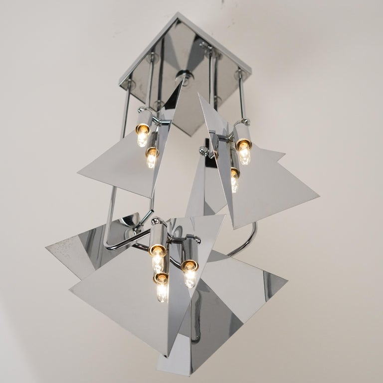 High quality polished chrome chandelier. Designed and manufactured in Italy, circa 1960s. Rewired for US junction boxes. Takes five E14 European candelabra bulbs.
