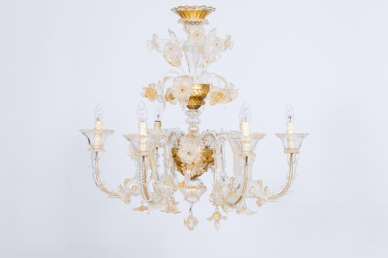 Italian chandelier in blown Murano glass 24-karat gold finishes, Giovanni Dalla Fina, 1980s This astonishing Murano glass chandelier abounds with floral decorations. A garden of leaves, flowers and fruits spreads out from the main stem. Six wavy
