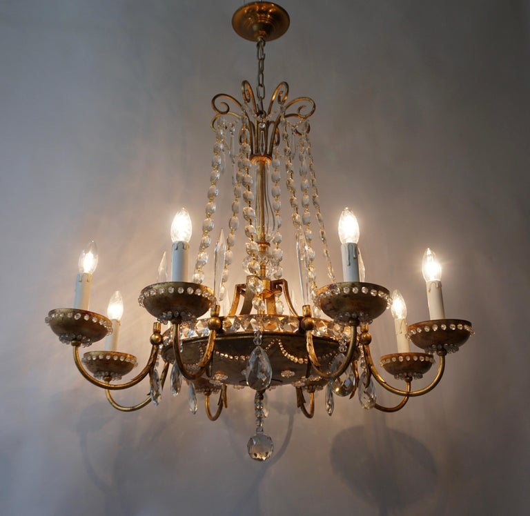 Large elegant Italian chandelier in brass and crystal. Diameter 84 cm. Height fixture 80 cm. Total height 110 cm. Four E27 bulbs. Eight E14 bulbs.