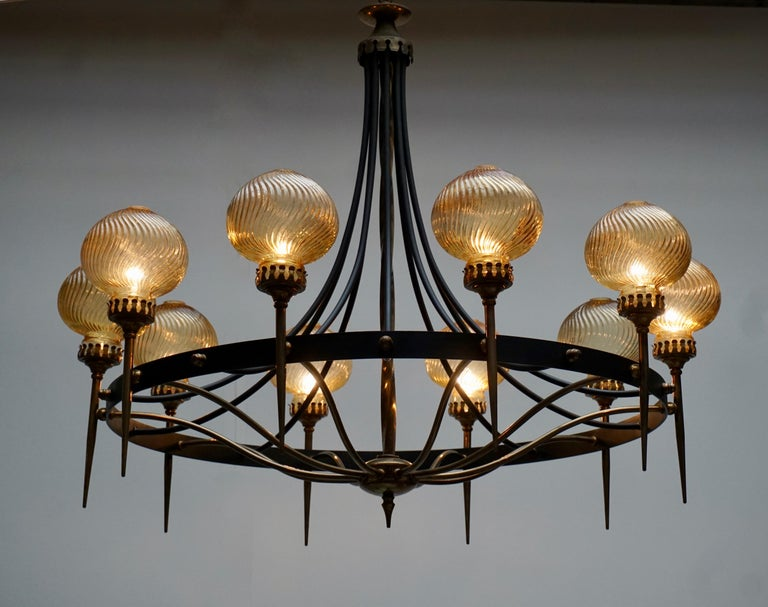 Large Italian chandelier in brass and metal with brown Murano glass coupes. Measures: Diameter 98 cm. Height fixture 80 cm. Total height with the chain is 180 cm. Ten E14 bulbs. The photo with the white glass coupes is not for sale.
