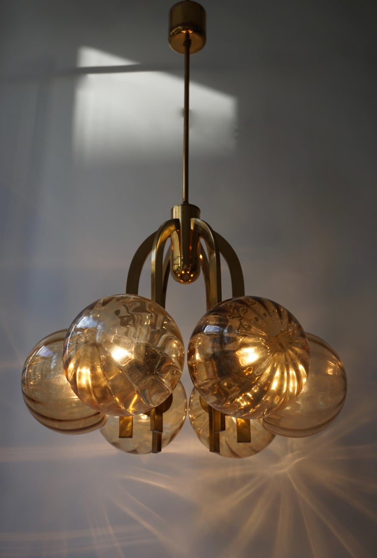 Italian chandelier in brass and Murano glass.
