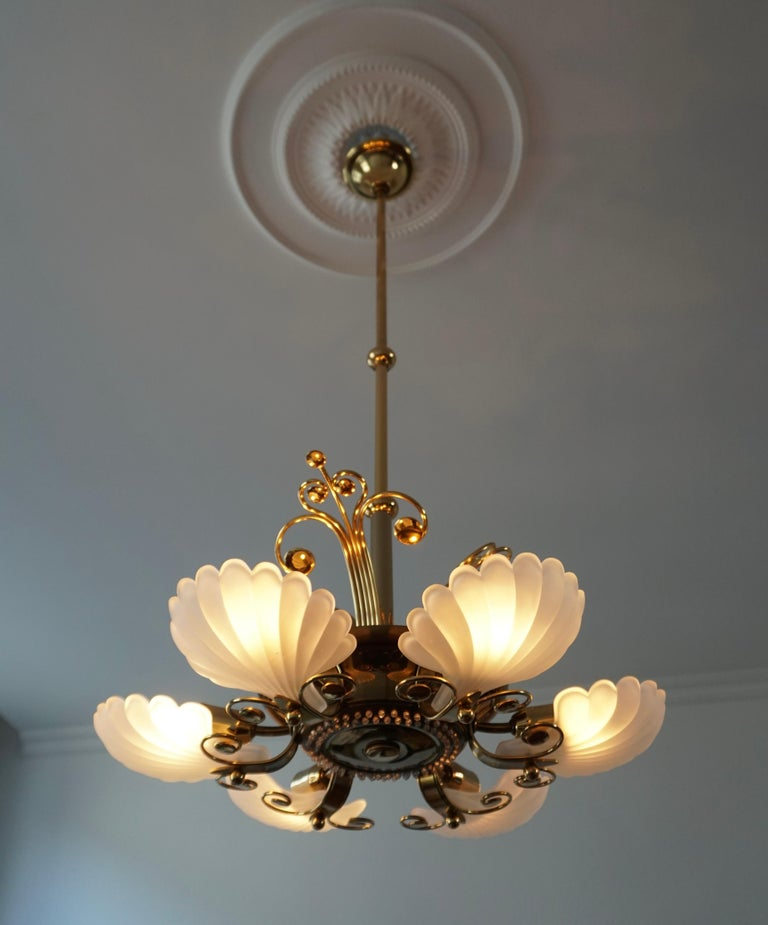 Wonderful chandelier made in Italy with six beautiful characteristic Murano frosted glass shells on a brass base.   Measures: Diameter 55 cm. Total height 115 cm. The brass rod can be shortened to 60 and 32 cm. The light requires nine single
