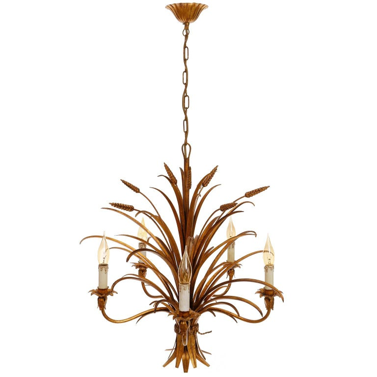 A Hollywood Regency five-arm light fixture from Italy manufactured in midcentury, circa 1970 (late 1960s or early 1970s). 