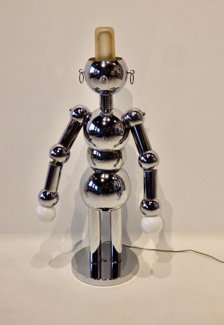 Chrome construction robot lamp. Inline switch lights all three bulbs. Bulbs are working now and included but not guaranteed. Pitting on some backside components and end cap pieces.