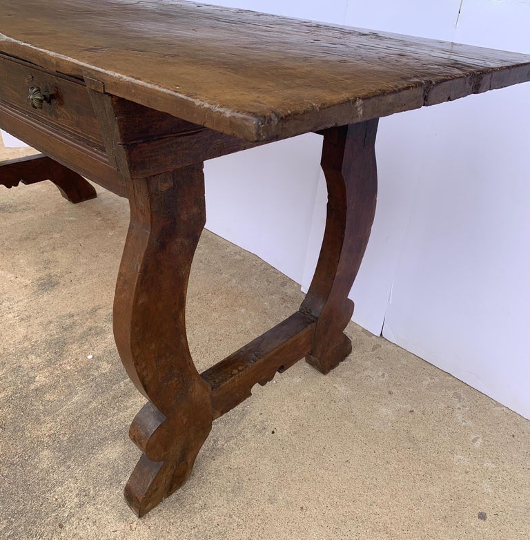 This is a beautiful console or desk from Tuscany made from Walnut. It's go so much character with the dove tail throughout and thick walnut single board top with great patina.