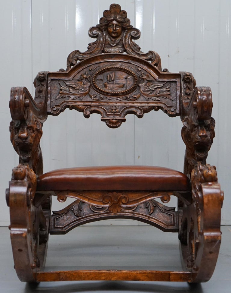 We are delighted to offer for sale this lovely very rare circa 1850 hand made in Venice Italy carved Fruitwood rocking armchair depicting Lions, Cherubs, a maiden, dragons and a small boat.  A fantastic looking and well made piece, this chair is a