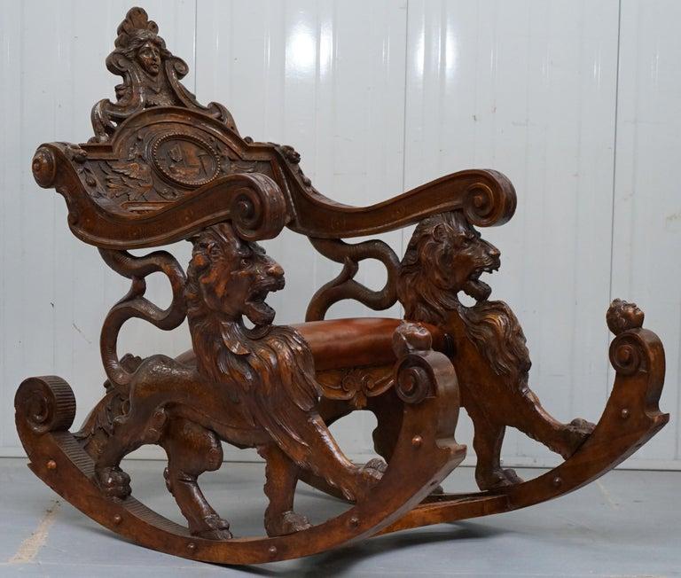Victorian Italian circa 1850 Fruitwood Restored Hand Carved Lion & Cherub Rocking Armchair For Sale