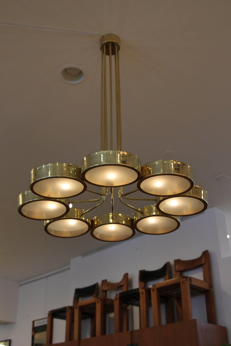 Italian brass pendant with eight circle glass discs resting inside brass stems. 