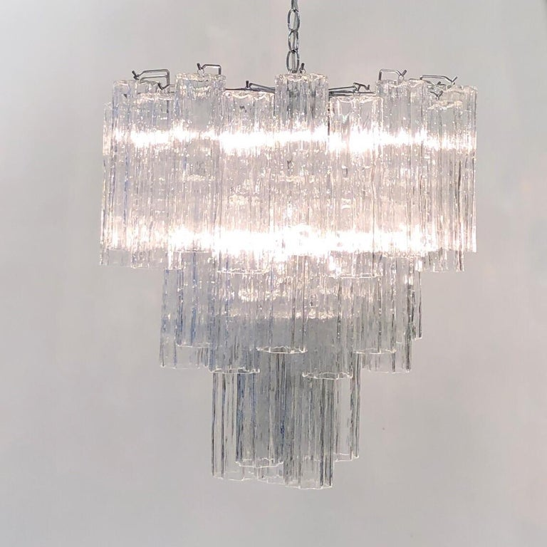 """A glamorous Italian chrome and clear Murano """"Tronchi"""" chandelier design by Venini in the 1970s. Newly rewired. Dimensions are for just the chandelier, not the chain. Let us know the length of chain that you need.   Dimensions: 24"""" high, 23"""""""