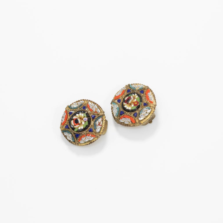 A pair of small but stylish Italian cloisonne button clip on earrings with blue, orange, white, and green floral motifs. Brass-tone setting.  Tags, Marks, Hallmarks: Italy (one earring)