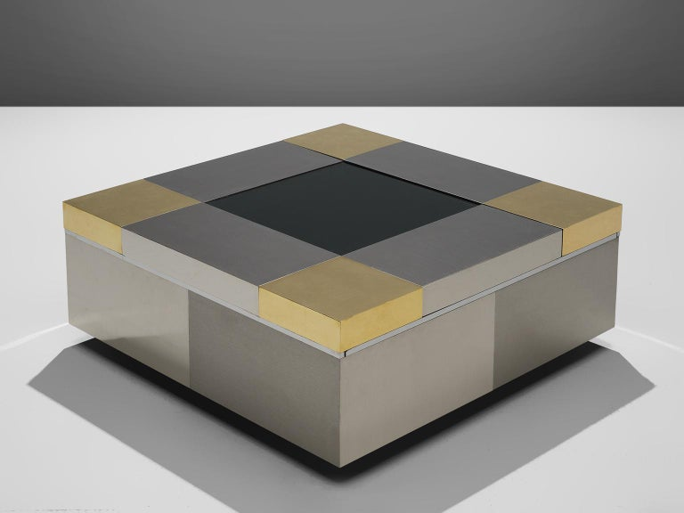 Coffee table, steel and brass, 1970s, Italy.  This coffee table features particular design aesthetics of postmodern Italian design that features traits of the design of Willy Rizzo. It features slick and clean look thanks to the combination of