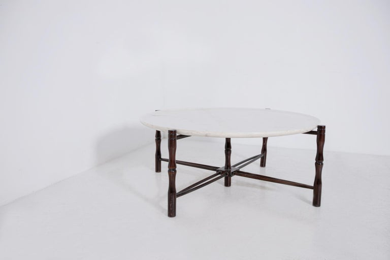 Small centre table by Giuseppe Scapinelli from the 1950s. The large coffee table is made of a walnut frame, which is carved and sculpted into its four supporting legs. At the centre of the walnut structure there is another leg which acts as a