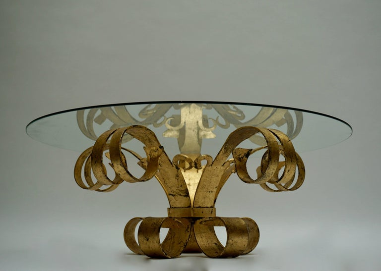 Elegant Italian gilded coffee table with glass top.