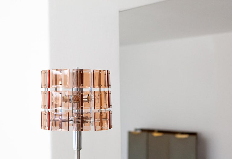 A base lamp manufactured in Italy during the 1970s   It is made of cognac/amber colored chrystal supported by a chromed steel stemand a marble base The object is in its original very condition, the chrome has shows little signs of rust in some