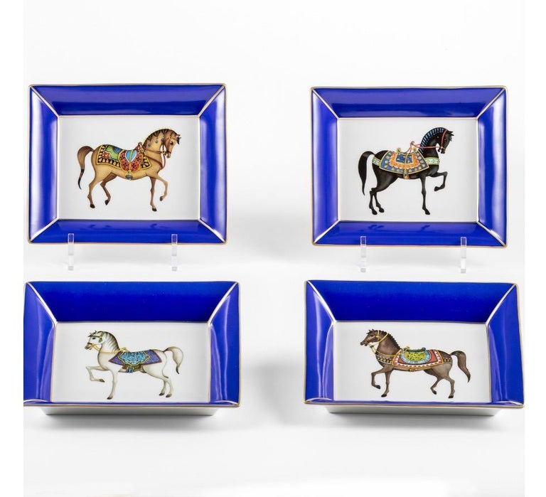 Italian craftsmanship pocket tray decorated with 4 different horses gold and blue border. Entirely made in Florence by our master craftsmen.  Artecornici design produces hand colored art prints, artisan frames, lightings, decorative accessories