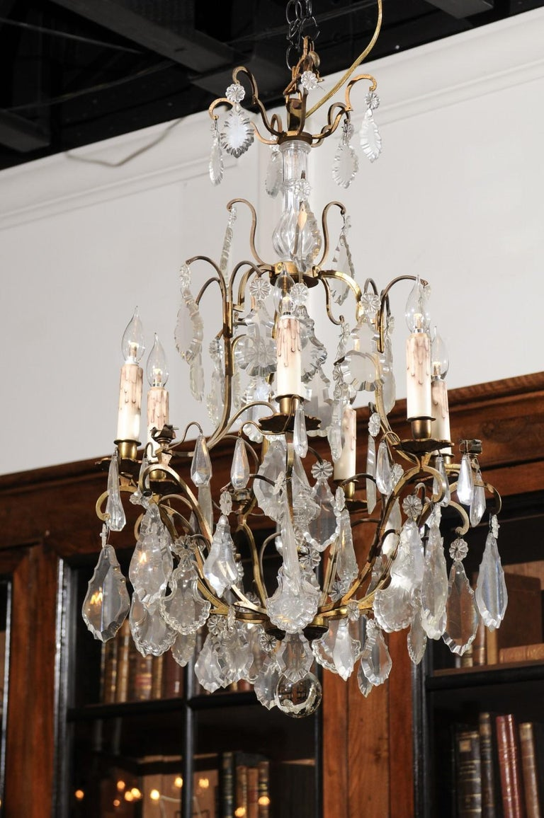 An Italian crystal and bronze six-light chandelier from the mid-19th century, with central obelisk, pendeloques and rosettes. Born in Italy during the third quarter of the 19th century, this elegant chandelier features a bronze armature supporting