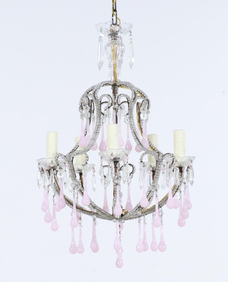 "Very pretty, 1950s Italian crystal beaded chandelier with pink opaline glass drops.   The chandelier consists of a shapely iron frame with a naturally-distressed gilt finish and original ""English cut"" beading on the arms. The pink opaline drops add"