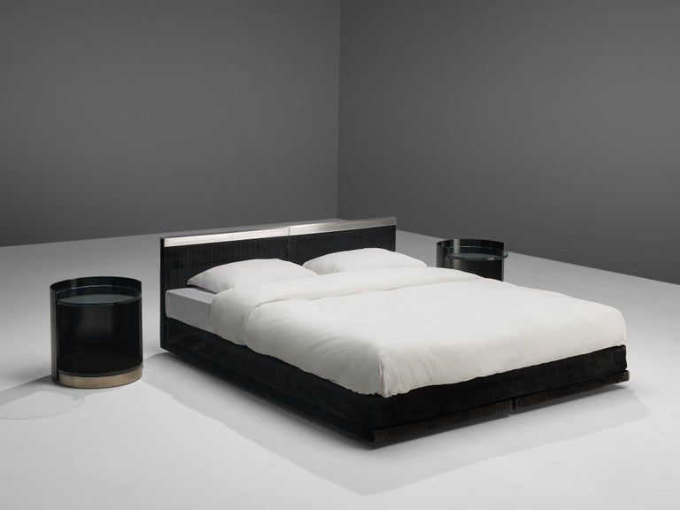 Gianni Moscatelli for Formanova, pair of side tables, wood, glass and metal, Italy, 1970s. Postmodern pair of nightstands by Gianni Moscatelli for Formanova. The tables have a cylindrical shape, featuring a black lacquered wood frame that is open
