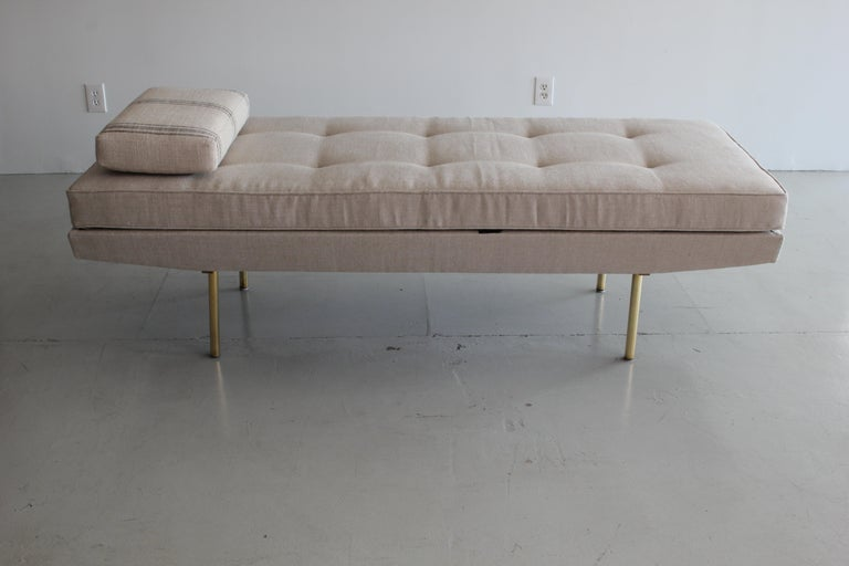 A Mid-Century Modern Italian upholstered mechanical daybed with cushion supported on straight brass legs, circa 1960. Can articulate up to seating chaise. Newly upholstered in natural linen.