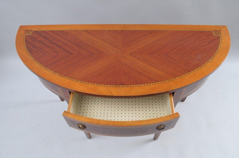 Italian demilune console hall table by Decorative Crafts Inc., Made in Italy. Item features wood construction, single drawer, banded and inlaid throughout, sunburst top, beautiful woodgrain, Hand crafted in Italy, Original labels to rear, circa 21st