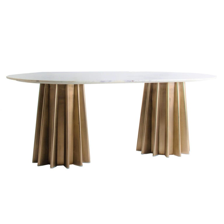 Italian design style oval dining table consisting of a graphic gilded metal feet with an oval white marble tray.