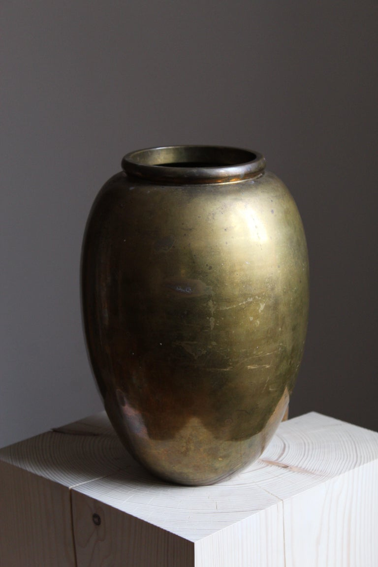 A large vase. Designed and produced in Italy, c. 1950s. In solid brass.