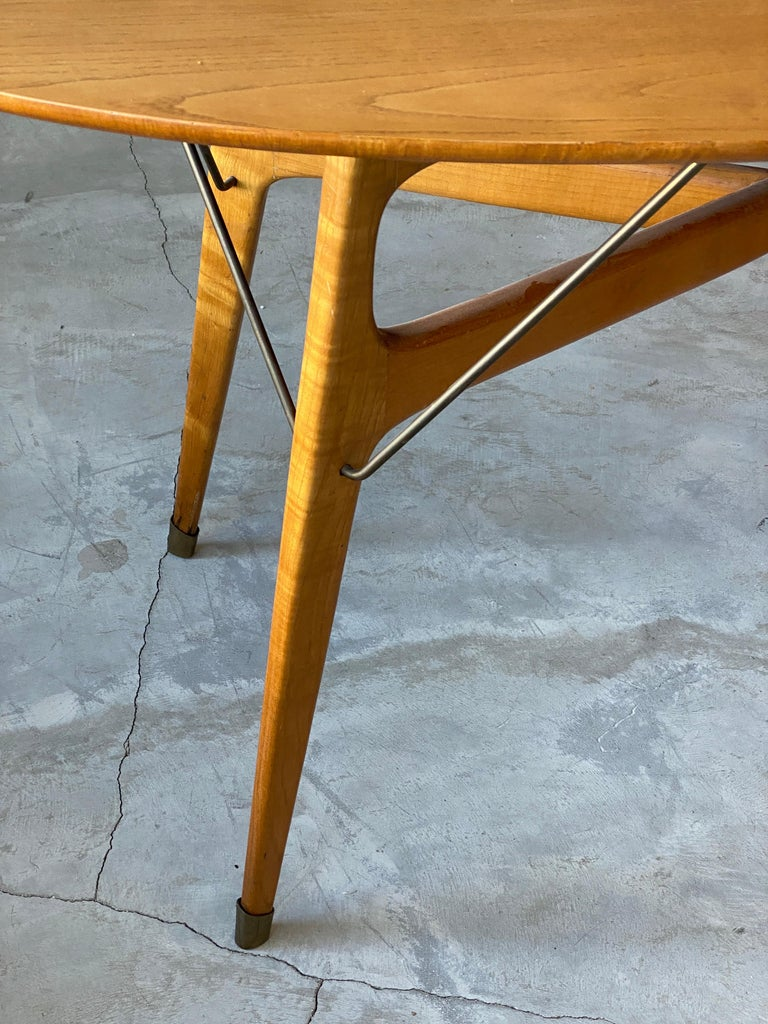 A small dinette / dining table. Finely sculpted solid beach reinforced with brass details.   Other designers of the period include Gio Ponti, Franco Albini, Paolo Buffa, Ico Parisi, and Carlo Mollino.