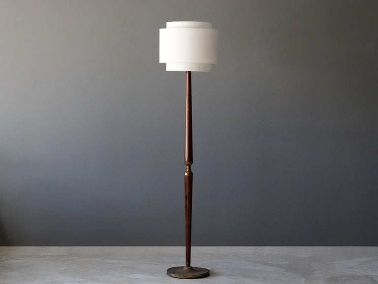A highly modernist floor lamp. In dark stained mahogany, brass. Later fabric screen.  Other designers and makers of the period include Angelo Lelii, Max Ingrand, Fontana Arte, Stilnovo, and Gino Sarfatti.