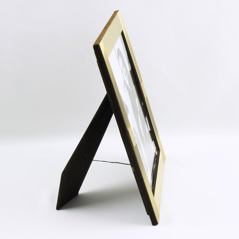Stunning modernist picture photo frame by Italian designer Noel B.C., Italy. Gilt brass geometric design with contrasted carving and polished accent. Back and easel in brown velvet. 